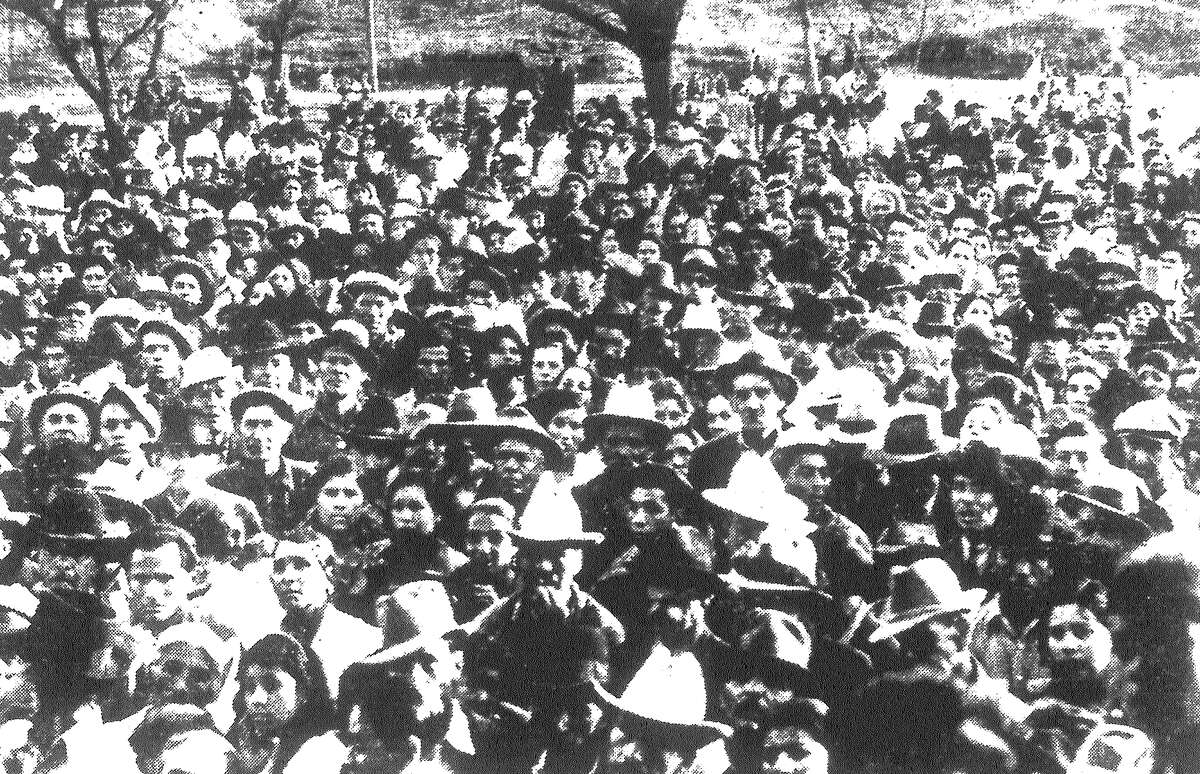 Four thousand striking pecan shellers and sympathizers hear Congress of Industrial Organizations (C.I.O.) leaders speak in Cassiano Park. The strike leadership of Donald Henderson, cannery union chief, was endorsed by the crowd at a meeting on the West Side Sunday. Published in the San Antonio Light Feb. 14, 1938.