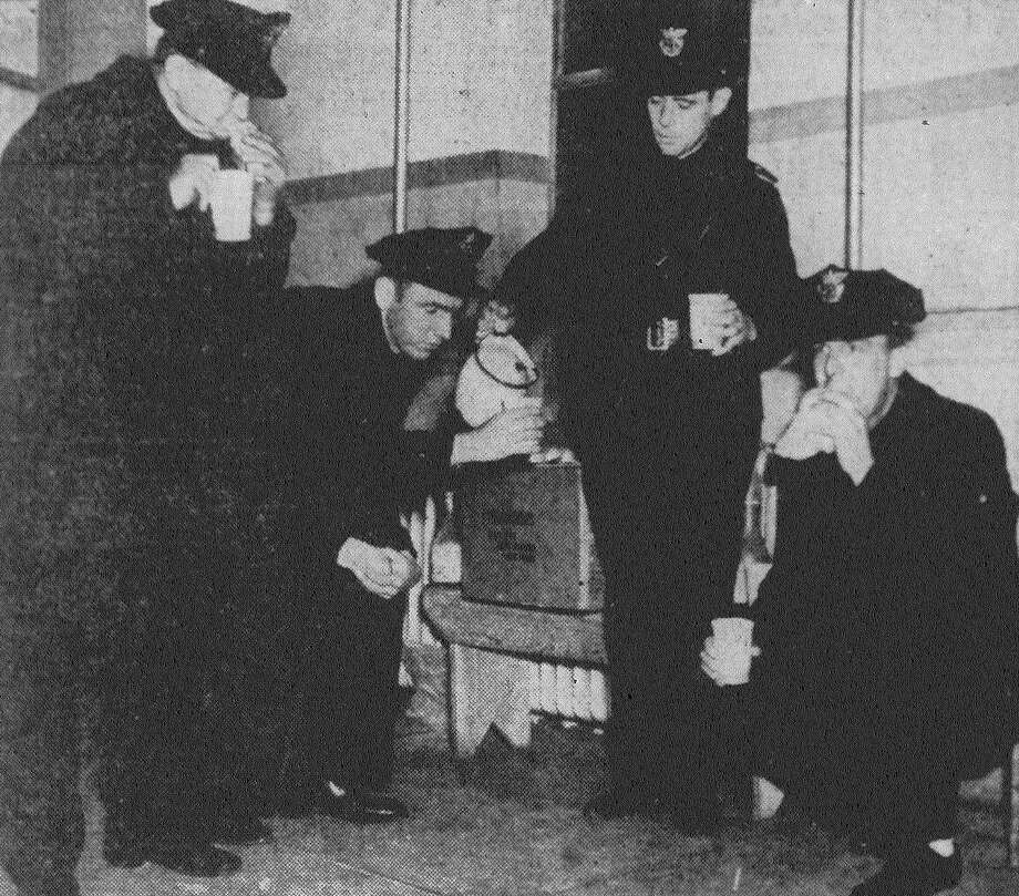 Policemen R.W. Winters, B. Vistuba, J.P. Needham and F.P. Palmer are shown having a snack at the police soup kitchen on the pecan shellers' strike front on the West Side. The 200 policemen and firemen on the front ate 1,500 sandwiches and drank 25 gallons of coffee on the kitchen's first day open. Published in the San Antonio News Feb. 18, 1938. Photo: File Photo