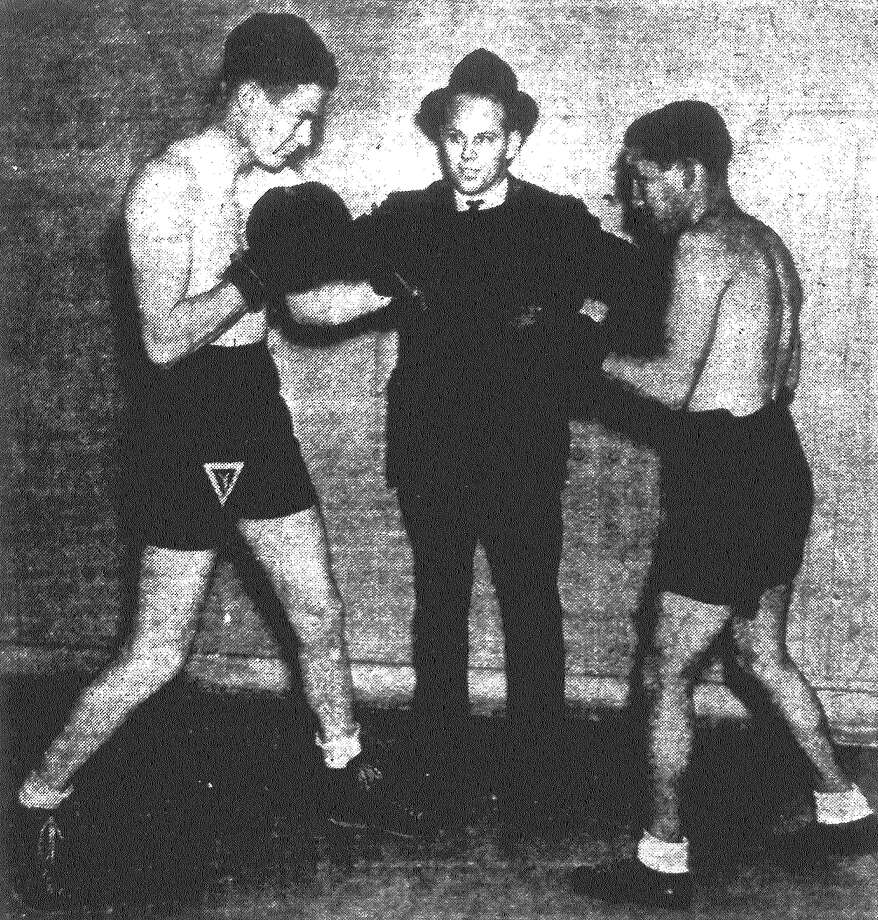 """YMCA boxing coach Delos Finch Jr. (center) gives last-minute instructions to middleweight J.C. Glass (left) and featherweight Fernando Vargas, San Antonio entrants in the Texas Golden Gloves Championships at Fort Worth. The Cowtown boxing show, for which the San Antonio """"Y"""" boxers qualified by downing Austin opponents, opens Thursday night. Published in the San Antonio Light Feb. 17, 1938. Photo: File Photo"""