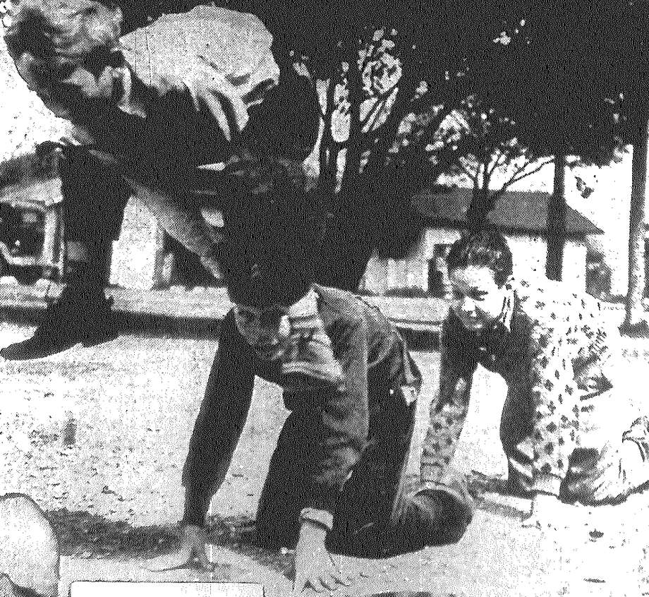 Bobby Lee Lessing is doing the leaping in a spontaneous game of leapfrog, another way to find fun in life. On hands and knees are Sam Liberto Jr. and D.P. McCulloch. Published in the San Antonio Express Feb. 20, 1938. Photo: File Photo