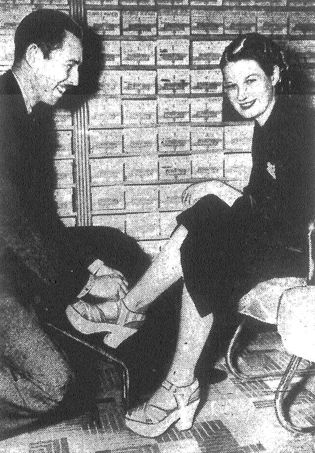 Chandler Boot Shop employees Amon Money and Mrs. Bobbie Wilson demonstrate new shoes called Susie Qs, after the dance craze. The shoes, with cork soles up to a couple inches thick, are also worn for dancing the Big Apple and being adopted for street wear as well. The shoes are easy to wear and comfortable, she said. Published in the San Antonio Light Feb. 20, 1938. Photo: File Photo