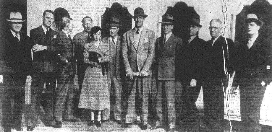 A welcoming committee greets movie star Randolph Scott (center) during quick stop in San Antonio on the way to La Mota Ranch. The welcomers include Lee Aronstein (from left) of the Palace Theater; Edward Collins, manager of the Majestic Theatre; Jack Chalman, local Interstate publicity director; Lance Heath, Paramount publicity man; Mary Louise Walliser, Evening News film reviewer; Frank O. Starz, director of Interstate theaters exploitation; Scott; William O'Donnell, city manager Interstate theaters; Eph Charninsky, director of Sun suburban theaters; Clarence Moss and Bill Farnsworth, Interstate publicity men. Published in the San Antonio News Feb. 26, 1938. Photo: File Photo