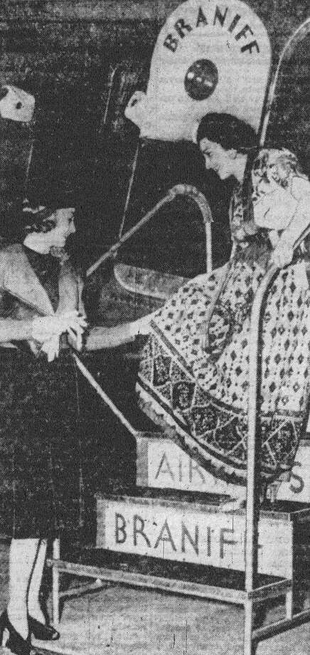 When the big airliner of Braniff Airways paused at Stinson Field last night it had aboard Miss Maria Romero, air hostess, who was garbed in a dress which she wore at the Charro Days Fiesta in Brownsville. Miss Romero is proudly showing her dress to Miss Dorothy Davis of San Antonio, who boarded the plane for Dallas. Last year, Miss Romero was the fiesta queen of New Mexico in a celebration held at Albuquerque. Published in the San Antonio News Feb. 26, 1938. Photo: File Photo