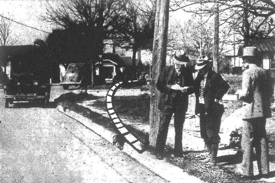 One of San Antonio's most hazardous street corners — in the 1700 block of Roosevelt Avenue into Highway No. 66 — is being eliminated by the highway department under the direction of Paul Steffler. The dotted line on the photo shows the course of the new route. Published in the San Antonio Light Feb. 25, 1938. Photo: File Photo