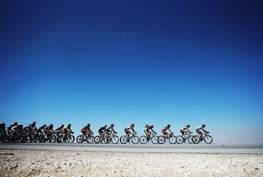 *** BESTPIX *** DOHA, QATAR - FEBRUARY 06:  The peloton makes its' way through the Qatar desert on stage four of the Tour of Qatar from Camel Race Track to Al Khor Corniche on February 6, 2013 near Camel Race Track, Qatar.  (Photo by Bryn Lennon/Getty Images) Photo: Bryn Lennon, Getty Images