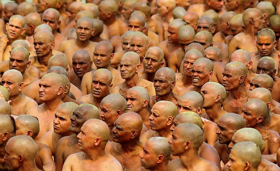 TOPSHOTS  Newly initiated 'naga sadhus' prepare to perform rituals on the banks of the Ganga River d