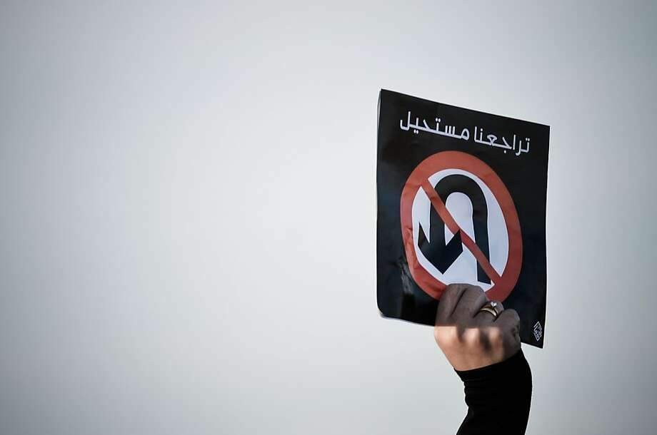 "Down with U-turns!A protester waves a placard at an anti-government rally to demand reforms  in the village of Diraz, Bahrain. The poster reads, ""Our retreat is impossible."" Photo: Mohammed Al-Shaikh, AFP/Getty Images"