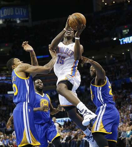 Oklahoma City Thunder guard Reggie Jackson (15) shoots between Golden State Warriors guard Kent Bazemore (20), forward Draymond Green (23) and guard Charles Jenkins (22) during the fourth quarter of an NBA basketball game in Oklahoma City, Wednesday, Feb. 6, 2013. Oklahoma City won 119-98. (AP Photo/Sue Ogrocki) Photo: Sue Ogrocki, Associated Press