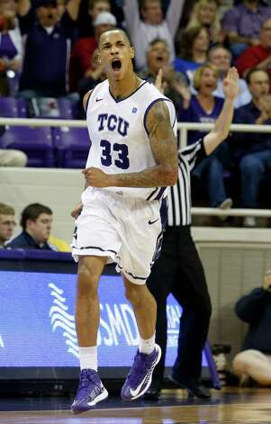 TCU forward Garlon Green (33) celebrates a 3-point shot during the first half of an NCAA college basketball game against Kansas on Wednesday, Feb. 6, 2013, in Fort Worth, Texas. (AP Photo/Sharon Ellman) Photo: Sharon Ellman