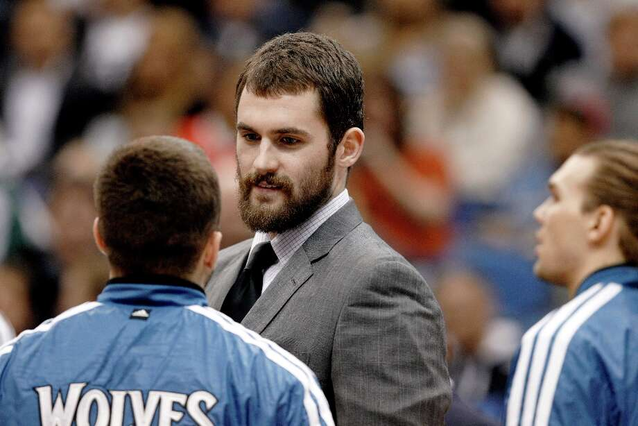 Injured Minnesota Timberwolves forward Kevin Love talks to teammates during a timeout during the first half of an NBA basketball game against the San Antonio Spurs Wednesday, Feb. 6, 2013 in Minneapolis. Photo: Genevieve Ross, Associated Press / FR170496 AP