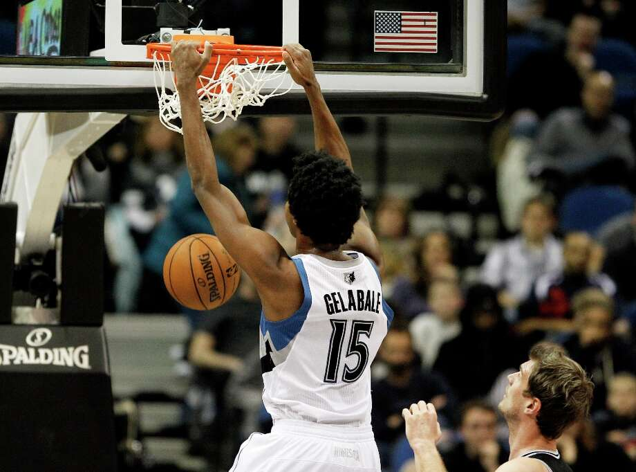 Minnesota Timberwolves forward Mickael Gelabale (15) dunks the ball against the San Antonio Spurs during the first half of an NBA basketball game Wednesday, Feb. 6, 2013 in Minneapolis. Photo: Genevieve Ross, Associated Press / FR170496 AP