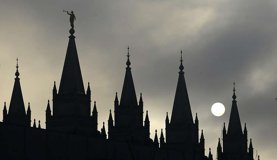 The Salt Lake Temple in Temple Square is silhouetted against the cloud-covered sky Wednesday, Feb. 6, 2013, in Salt Lake City.  (AP Photo/Rick Bowmer) Photo: Rick Bowmer, Associated Press