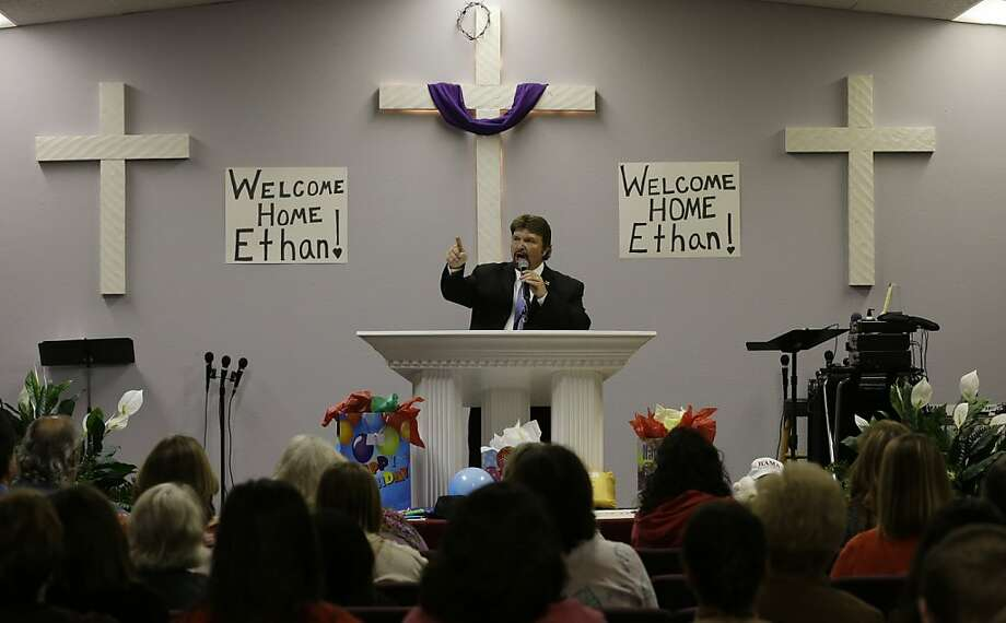 Pastor Michael Senn preaches during a celebration for Ethan, the boy who was held hostage for a week in an underground bunker, Wednesday, Feb. 6, 2013 at the Midway Assembly of God in Midland City, Ala. Ethan, who was rescued Monday, turned six on Wednesday. His captor, Jimmy Lee Dykes, was killed during the rescue operation. (AP Photo/Dave Martin) Photo: Dave Martin, Associated Press