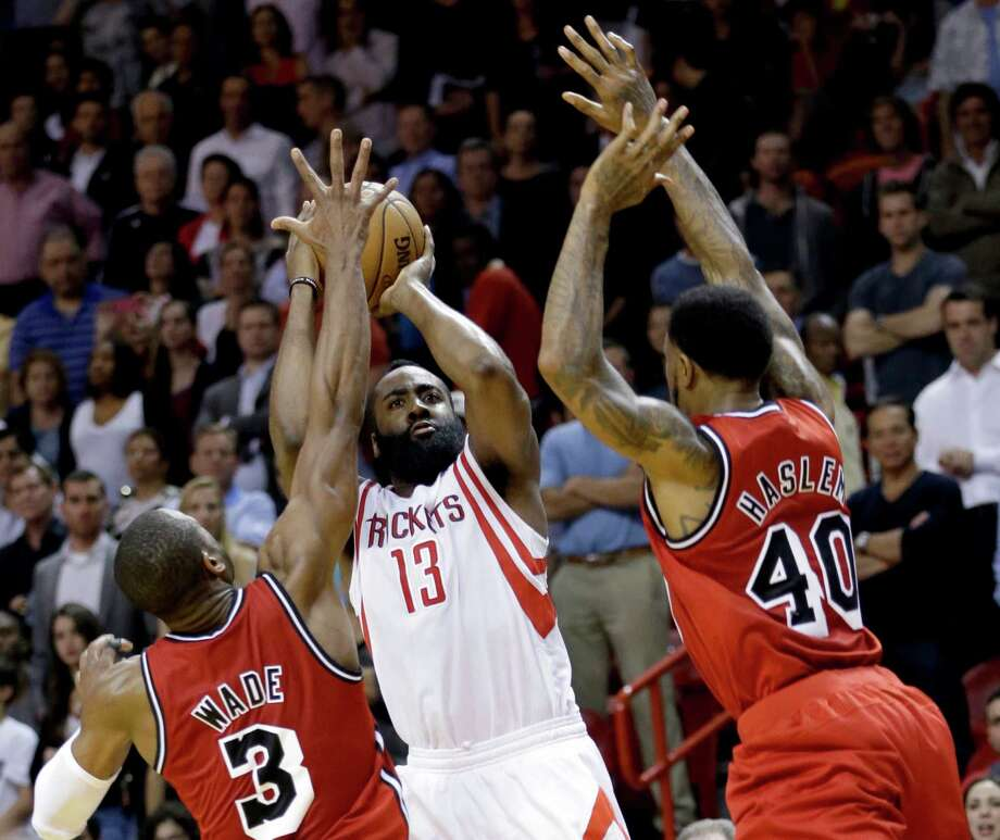 The Heat's Dwyane Wade (3) helps snuff out a Rockets rally by blocking James Harden's shot. Photo: Wilfredo Lee, STF / AP