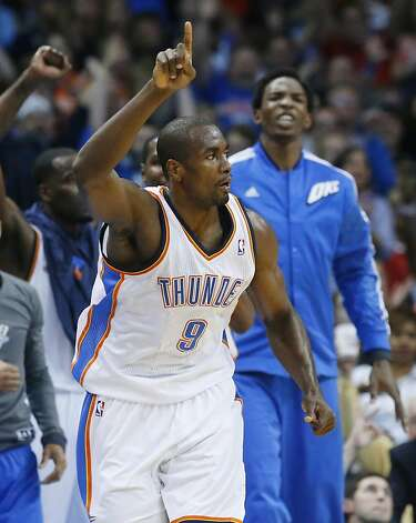 Oklahoma City Thunder forward Serge Ibaka reacts after hitting a 3-point shot against the Golden State Warriors in the first quarter of an NBA basketball game in Oklahoma City, Wednesday, Feb. 6, 2013. (AP Photo/Sue Ogrocki) Photo: Sue Ogrocki, Associated Press