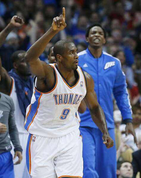 Oklahoma City Thunder forward Serge Ibaka reacts after hitting a 3-point shot against the Golden Sta