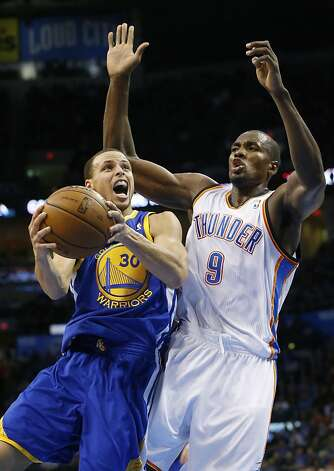 Golden State Warriors guard Stephen Curry (30) goes up for a shot in front as Oklahoma City Thunder forward Serge Ibaka defends during the second quarter of an NBA basketball game in Oklahoma City, Wednesday, Feb. 6, 2013. Oklahoma City won 119- 98. (AP Photo/Sue Ogrocki) Photo: Sue Ogrocki, Associated Press