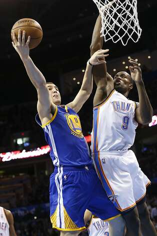 Golden State Warriors guard Klay Thompson (11) shoots in front of Oklahoma City Thunder forward Serge Ibaka (9) in the first quarter of an NBA basketball game in Oklahoma City, Wednesday, Feb. 6, 2013. Oklahoma City won 119-98. (AP Photo/Sue Ogrocki) Photo: Sue Ogrocki, Associated Press