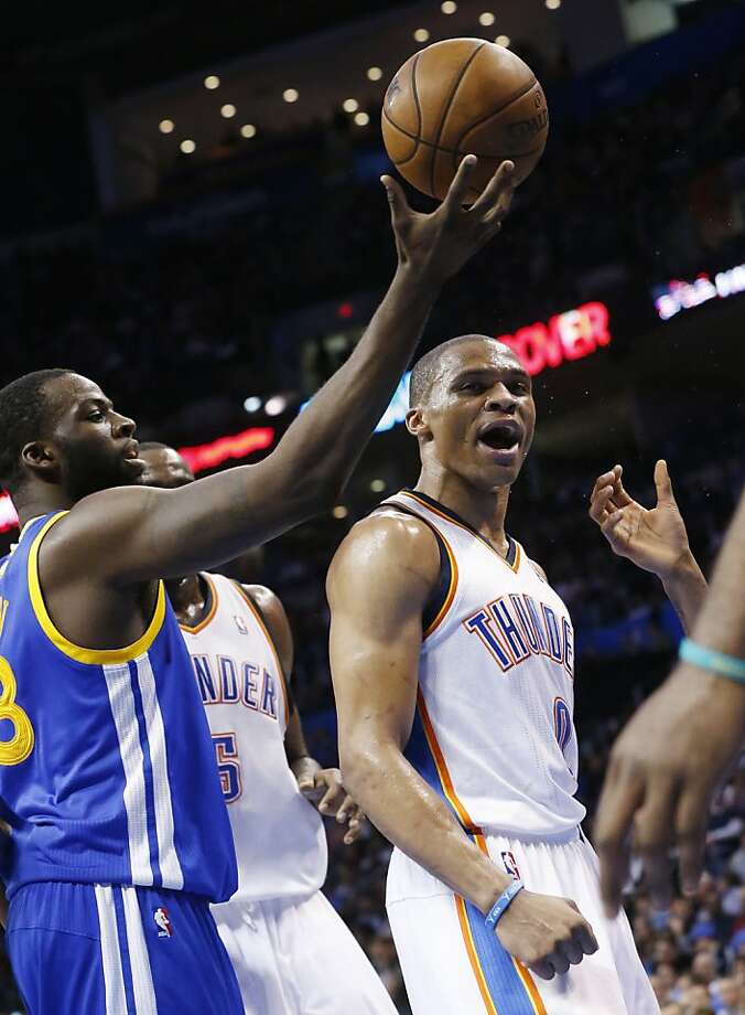 Oklahoma City Thunder guard Russell Westbrook (0) reacts in front of Golden State Warriors forward Draymond Green (23) after hitting a shot in the third quarter of an NBA basketball game in Oklahoma City, Wednesday, Feb. 6, 2013. Oklahoma City won 119-98. (AP Photo/Sue Ogrocki) Photo: Sue Ogrocki, Associated Press
