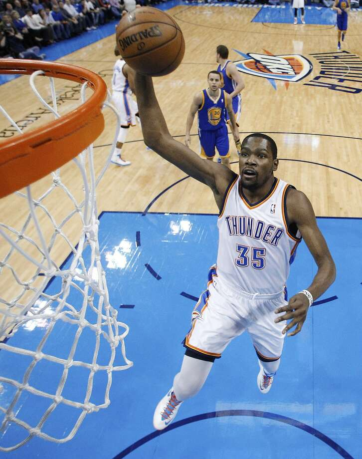 Oklahoma City Thunder forward Kevin Durant (35) shoots against the Golden State Warriors during the third quarter of an NBA basketball game in Oklahoma City, Wednesday, Feb. 6, 2013. Oklahoma City won 119-98. (AP Photo/Sue Ogrocki) Photo: Sue Ogrocki, Associated Press