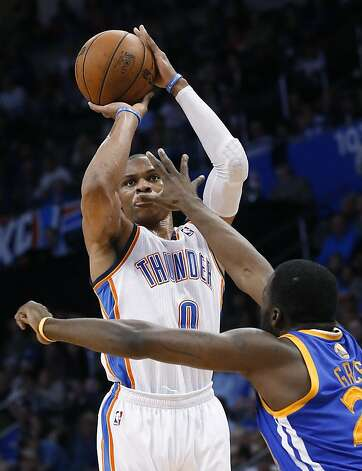 Oklahoma City Thunder guard Russell Westbrook (0) shoots over Golden State Warriors forward Draymond Green during the third quarter of an NBA basketball game in Oklahoma City, Wednesday, Feb. 6, 2013. Oklahoma City won 119-98. (AP Photo/Sue Ogrocki) Photo: Sue Ogrocki, Associated Press