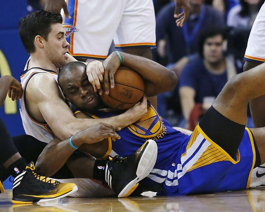 Oklahoma City Thunder forward Nick Collison, left, and Golden State Warriors forward Carl Landry, right, scramble for control of the ball in the fourth quarter of an NBA basketball game in Oklahoma City, Wednesday, Feb. 6, 2013. Oklahoma City won 119-98. (AP Photo/Sue Ogrocki) Photo: Sue Ogrocki, Associated Press