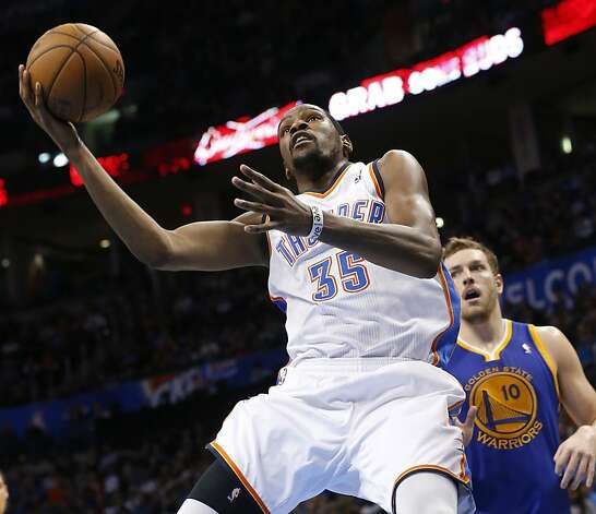 Oklahoma City Thunder forward Kevin Durant (35) shoots in front of Golden State Warriors forward David Lee (10) in the third quarter of an NBA basketball game in Oklahoma City, Wednesday, Feb. 6, 2013. Oklahoma City won 119-98. (AP Photo/Sue Ogrocki) Photo: Sue Ogrocki, Associated Press