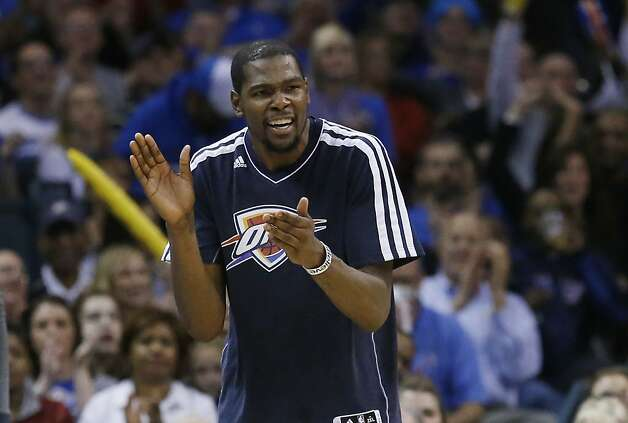 Oklahoma City Thunder forward Kevin Durant cheers following a basket by a teammate against the Golden State Warriors in the fourth quarter of an NBA basketball game in Oklahoma City, Wednesday, Feb. 6, 2013. Oklahoma City won 119-98. (AP Photo/Sue Ogrocki) Photo: Sue Ogrocki, Associated Press