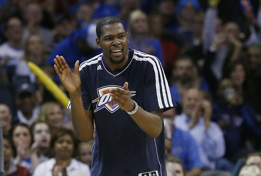 Oklahoma City Thunder forward Kevin Durant cheers following a basket by a teammate against the Golde
