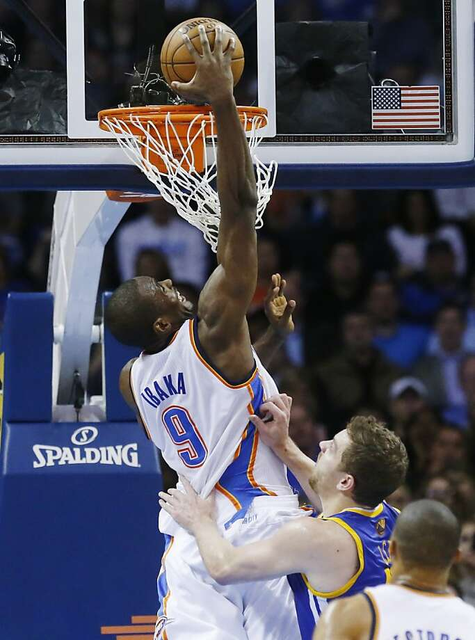 Oklahoma City Thunder forward Serge Ibaka shoots in front of Golden State Warriors forward David Lee during the second quarter of an NBA basketball game in Oklahoma City, Wednesday, Feb. 6, 2013. (AP Photo/Sue Ogrocki) Photo: Sue Ogrocki, Associated Press
