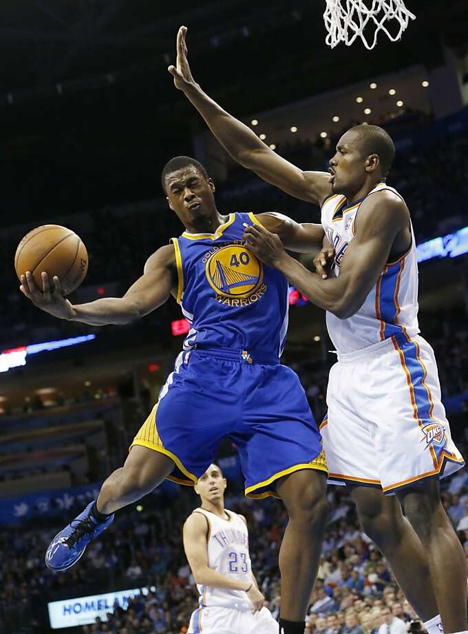 Golden State Warriors forward Harrison Barnes (40) goes up for a shot while defended by Oklahoma City Thunder forward Serge Ibaka during the second quarter of an NBA basketball game in Oklahoma City, Wednesday, Feb. 6, 2013. (AP Photo/Sue Ogrocki) Photo: Sue Ogrocki, Associated Press