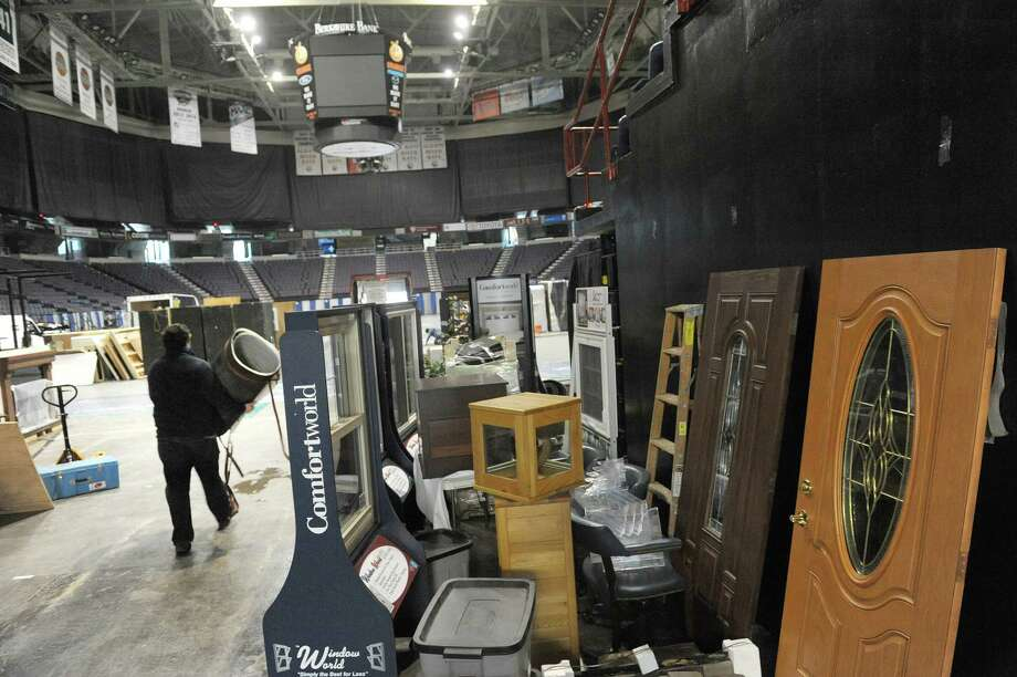 Workers bring in items as businesses and organizations began setting up for the 33rd Annual Great Northeast Home Show at the Times Union Center on Wednesday, Feb. 6, 2013 in Albany, NY.  The show starts Friday and runs through Sunday.  (Paul Buckowski / Times Union) Photo: Paul Buckowski  / 00020756A