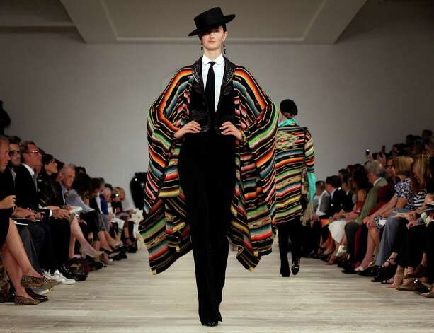 FILE - In this Thursday, Sept. 13, 2012 file photo, the Ralph Lauren Spring 2013 collection is modeled during Fashion Week in New York. Ralph Lauren is reporting their fourth quarter 2012 earnings on Wednesday, Feb. 6, 2013. (AP Photo/Richard Drew, File) Photo: Richard Drew
