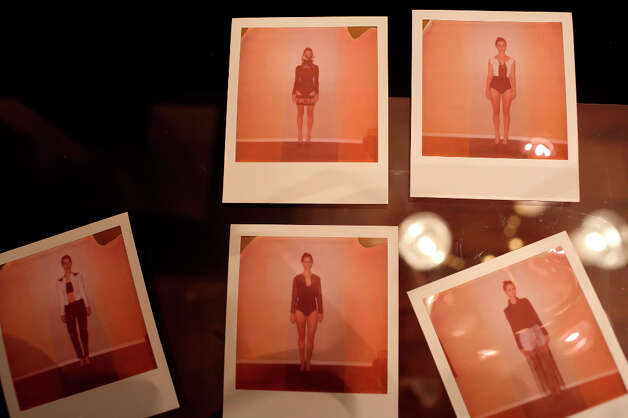 Polaroids for model cards for the show's lineup of Haley Cook wearing designs by Samantha Plasencia of the collection she'll be showing at Mercedes-Benz Fashion Week in New York lay on the table at her home in San Antonio on Thursday, Jan. 31, 2013. Photo: Lisa Krantz, San Antonio Express-News / © 2012 San Antonio Express-News