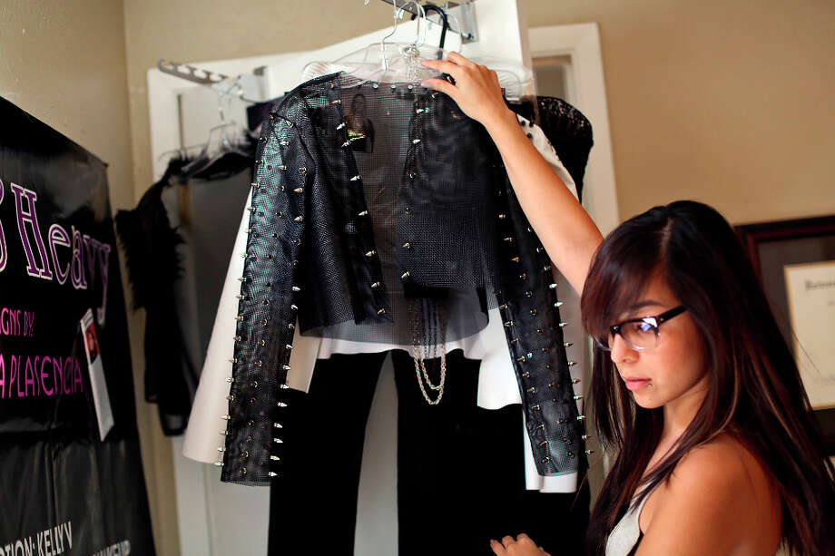 Designer Samantha Plasencia puts the finishing touches on the collection she'll be showing at Mercedes-Benz Fashion Week in New York, at her home in San Antonio on Thursday, Jan. 31, 2013. Photo: Lisa Krantz, San Antonio Express-News / © 2012 San Antonio Express-News