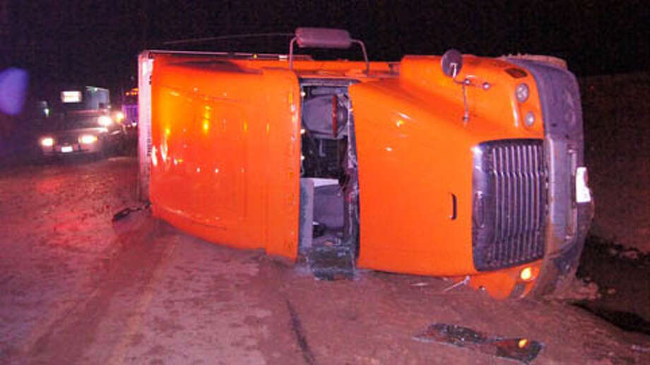 An 18-wheeler loaded with 21 tons of sausage ran off the road and rolled over about 1 a.m. Thursday on the southbound feeder of Interstate 45 near FM 1097 in the Willis area. (Scott Engle / Montgomery County Police Reporter) Photo: Montgomgery County Police Reporter