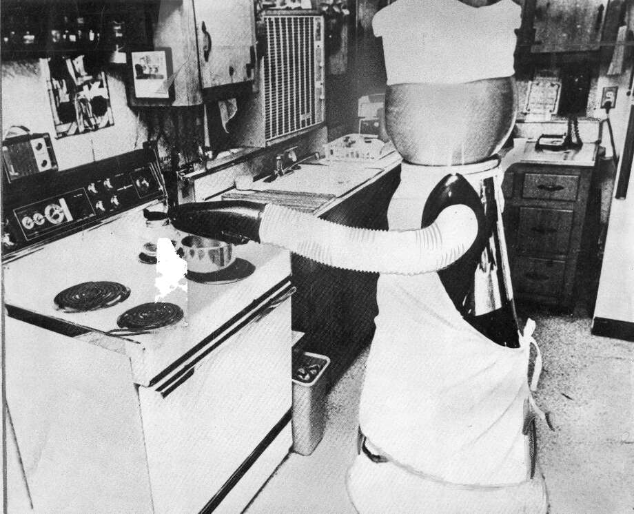 Nov. 13, 1979: Behold the Quasar Industries household robot, which was photographed cooking, cleaning and walking the dog -- and was 18 to 22 months away from mass production according to repeated promises throughout the late 1970s and early 1980s. Real journalists believed this. Photo: Chronicle File / ONLINE_YES