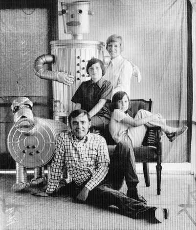 Au. 2, 1974: Ralph Trinity and his family display their robot Rusty and his wonder dog Spectron. While the robots look like a beloved part of the family, they had very limited capabilities and performed for schools and benefits, according to an Associated Press story. Photo: Associated Press / ONLINE_YES