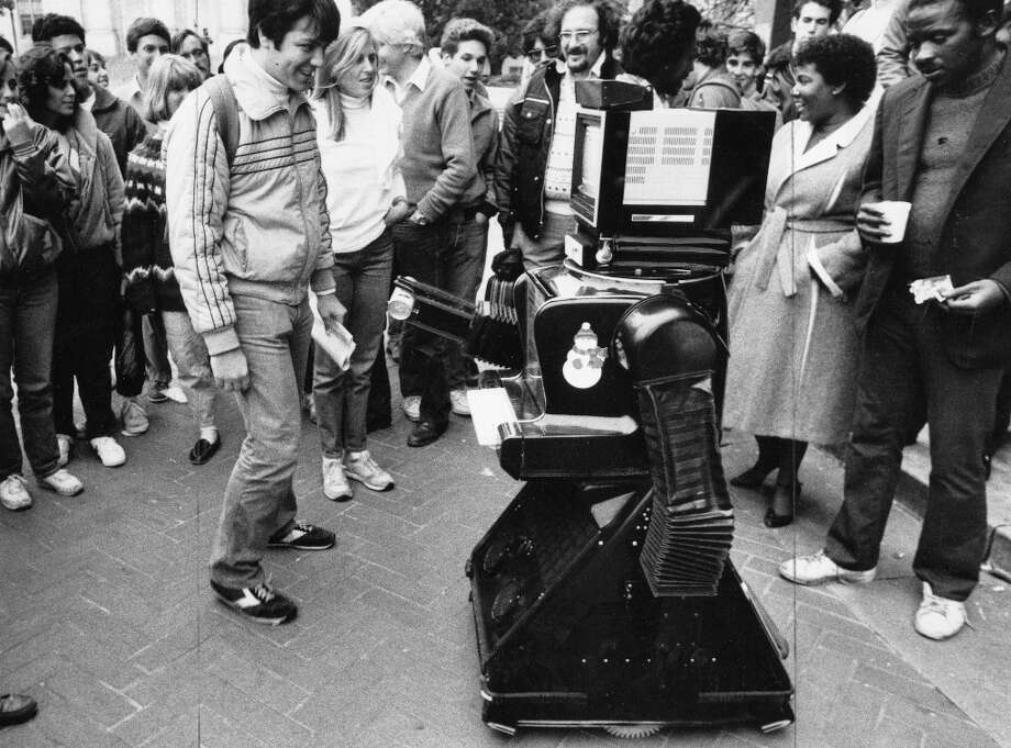 Nov. 28, 1984: By the mid-1980s, promotional robots were common. In TV and film including Days of Our Lives and Rocky IV,  they appeared to have intelligence, although they were usually remote controlled. Here the Mr. T Telebot shills Pepsi to students at U.C. Berkeley. Photo: Jerry Telfer, The Chronicle / ONLINE_YES