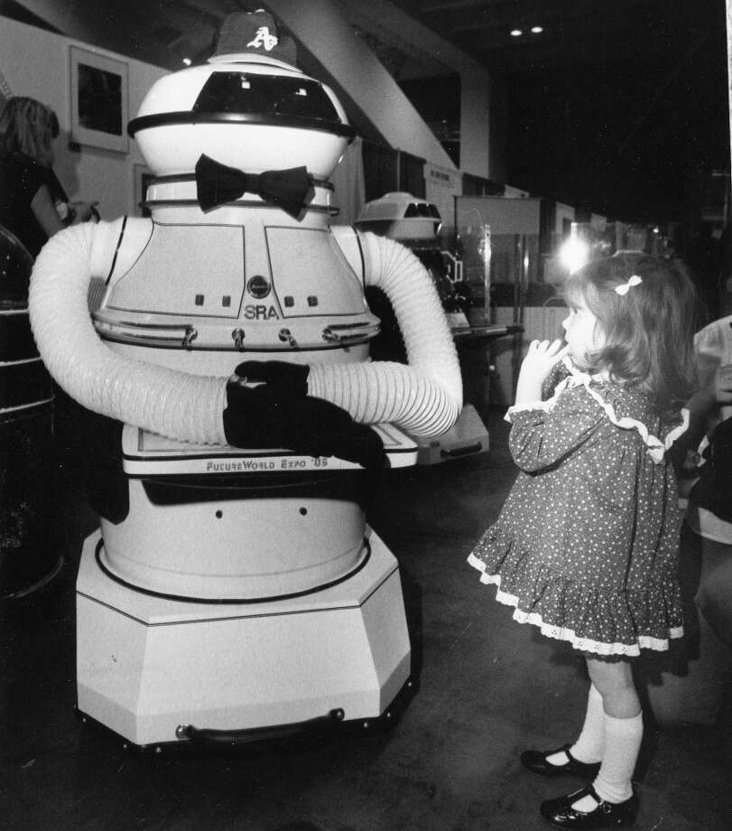 April 1, 1985: A robot on display at the 1985 Future World Expo at Moscone Center. By the mid-1980s, most free-thinking consumers had figured robot butlers weren't coming any time soon. But robots like the PanderBot Mark III (I made up that name -- note the A's hat) were still popular with kids. Photo: Vince Maggiora, The Chronicle / ONLINE_YES
