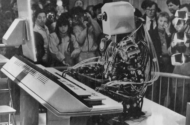 March 18, 1985: No sham here. The Wasubot actually plays a keyboard for a crowd in Japan. Judging by his finger placement, I'm guessing Your Song by Elton John. I believe there was a period later in the 1980s, after a falling out with Rick Wakeman, when this robot played keys for Yes. Photo: Associated Press / ONLINE_YES