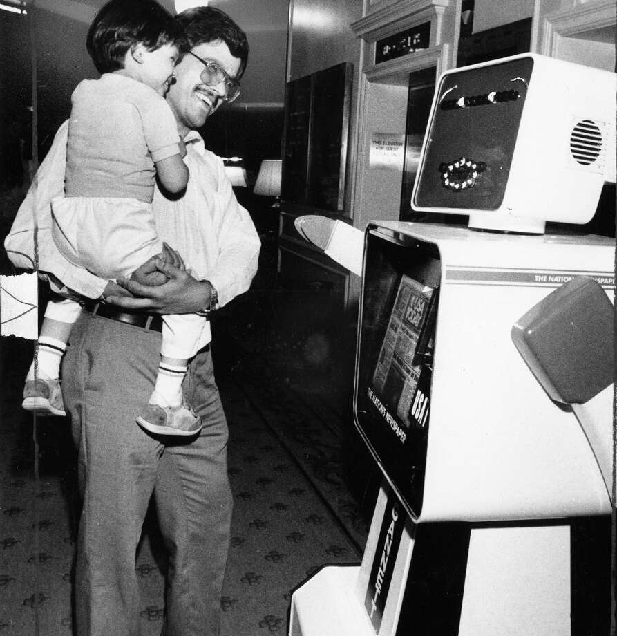 April 20, 1986: The Gannett newspapers chain debuts the USA Today PieChartBot (I made that name up, too) in the lobby of the Fairmont Hotel. Not going to make any more fun of this one. I'm convinced newspaper rack/robot hybrids could have saved print journalism in the long term. Photo: Fred Mertz, The Chronicle / ONLINE_YES