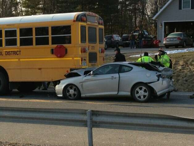 A car struck the rear end of a Guilderland school bus on Thursday, Feb. 7, 2013. It was unclear if anyone was hurt. (Skip Dickstein / Times Union)