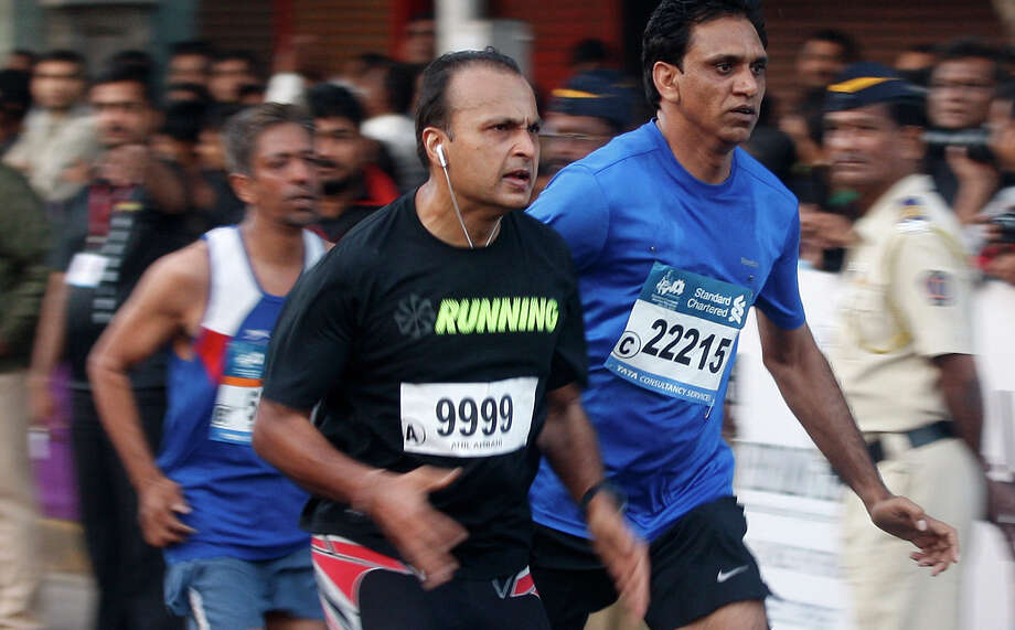 Reliance ADA Group CEO Anil Ambani took up marathon running after someone questioned his appearance during an investor's conference. He's been an avid runner since.Source: Business Insider Photo: Rafiq Maqbool, AP / AP