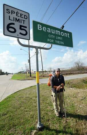Ken Ilgunas arrives at the Beaumont city limits from the west on Tx. 105 Tuesday afternoon after following the path of the proposed Keystone XL pipeline originating in Hardisty, Alberta in Canada. He's hiked the more than 1,700 miles sine mid-September 2012. photo provided by Pete Churton