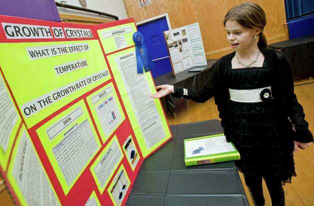 Caitlin Gage, a sixth-grader at St. Joseph School on Main Street in Danbury, discusses her science project, which earned a first place ribbon at the school's science fair. Wednesday, Feb. 6, 2013 Photo: Scott Mullin / The News-Times Freelance