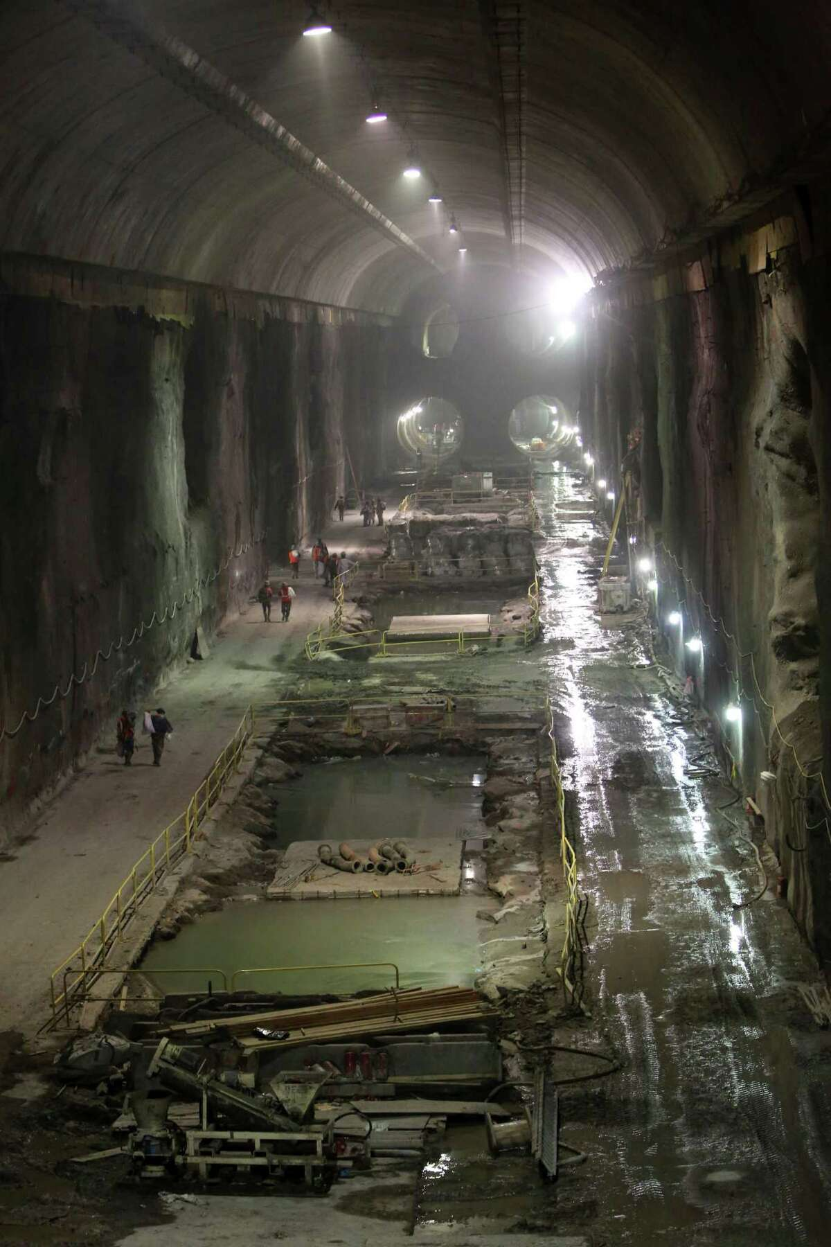In this Tuesday, Jan. 29, 2013 photo, contractors work on the East Side Access project beneath midtown Manhattan, in New York. The East Side Access is one of three bold projects under New York that will expand what's already the nation's biggest mass-transit system by 2019.