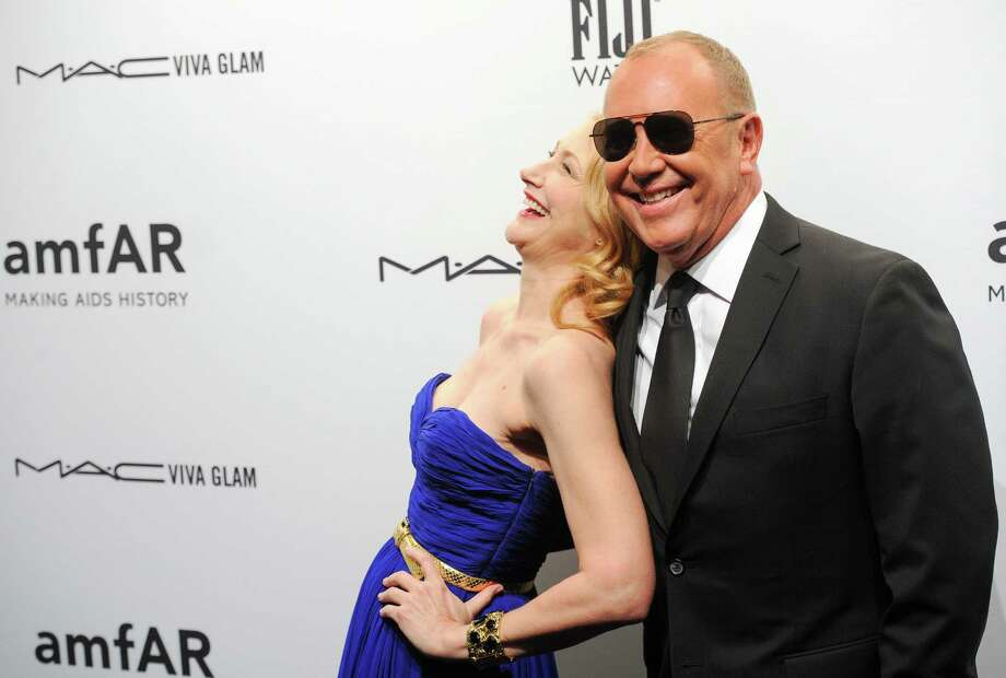 Actress Patricia Clarkson and designer Michael Kors attend amfAR's New York gala at Cipriani Wall Street on Wednesday, Feb. 6, 2013 in New York. Photo: Evan Agostini, Evan Agostini/Invision/AP / Invision