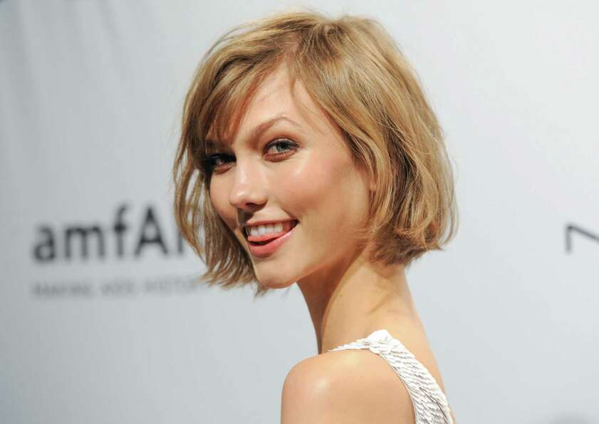Model Karlie Kloss attends amfAR's New York gala at Cipriani Wall Street on Wednesday, Feb. 6, 2013
