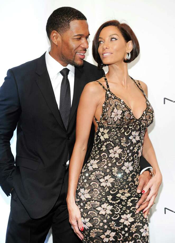Television personality Michael Strahan and girlfriend Nicole Murphy attend amfAR's New York gala at Cipriani Wall Street on Wednesday, Feb. 6, 2013 in New York. Photo: Evan Agostini, Evan Agostini/Invision/AP / Invision